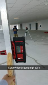 Surveying concrete slab elevations with laser level