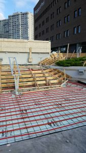 Field review of formwork and glycol heating system prior to concrete pour